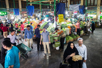 People buy vegetables and fruits at the Tajrish Bazaar in northern part of Tehran