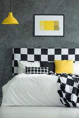 Black, white and yellow pillow