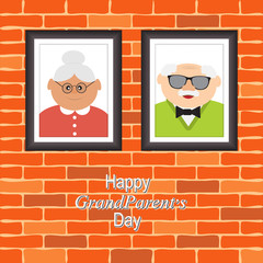 Greetings card  on grandparents day with the phrase and portraits of grandfather and grandmother.