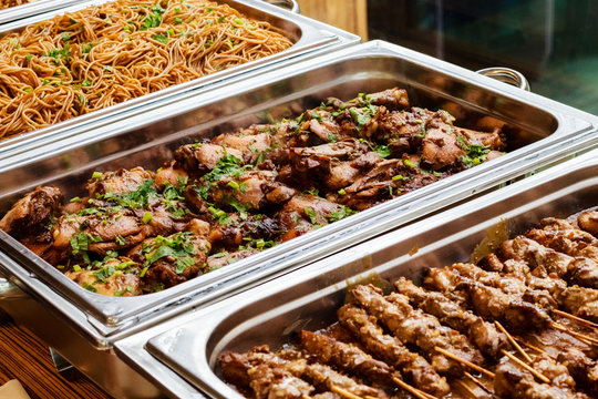 Catering Buffet Food Dish Asian Oriental With Meat And Colorful Vegetables