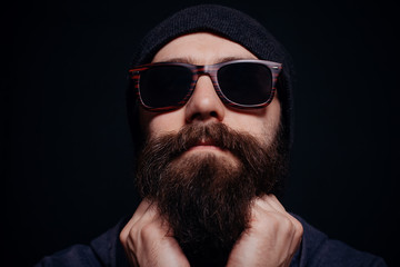 Handsome male big beard in glasses and hat