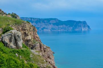 Steep, sharp, stone beaches on the Black Sea coast, in the vicinity of the city of Sevastopol of the Republic of Crimea, 2017