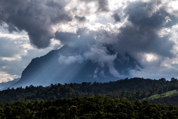 Amazing mountain scenic spot in Chiang Dao province in Thailand with stunning cloudy sky with ray of sunlight, beautiful nature background