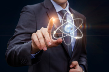 Businessman touches of the atom .