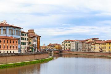 Riverside buildings at river Arno in Pisa, Italy