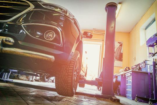 Car in garage of auto repair service shop