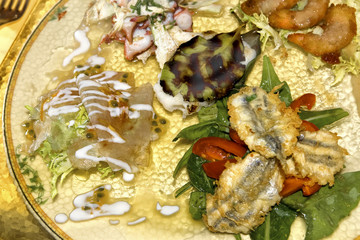 mixed fishes served usually as starter