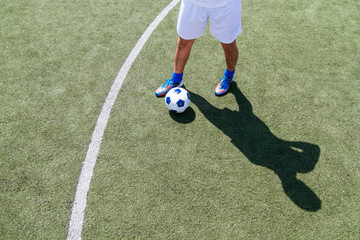 High angle view of the legs of a soccer player on the field
