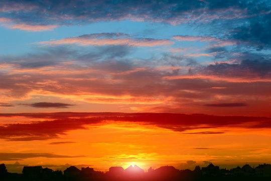 Beautiful summer sunset over the village.