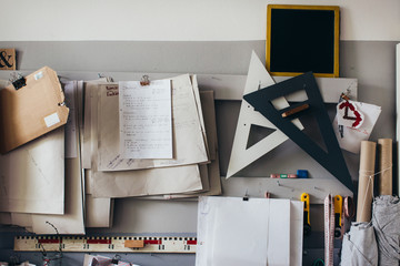 Paper Notes and Tools Hanging on Wall in DIY Atelier