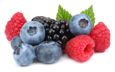 mix of blueberries, blackberries, raspberries isolated on white background