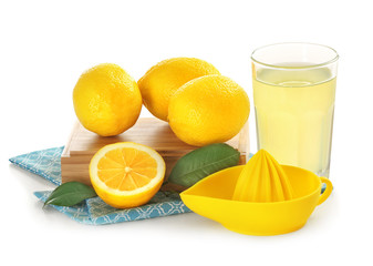 Composition with lemons, squeezer and glass of juice on white background