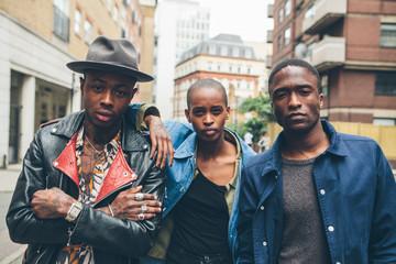 Three Fashionable friends in an urban setting