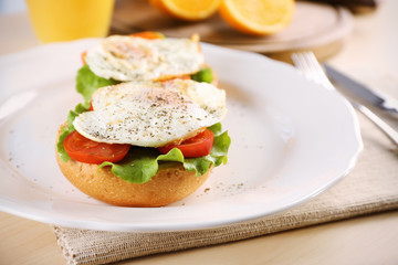 Closeup view of plate with delicious egg sandwiches on table