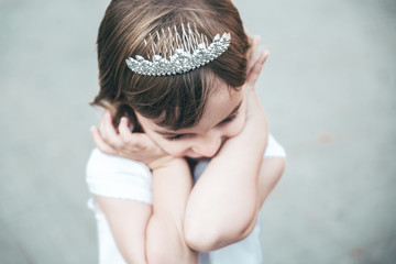 Portrait of a beautiful little girl with a diadem