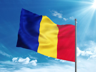 Romania flag waving in the blue sky