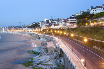 Wall Mural - City of San Sebastian illuminated at night, Spain