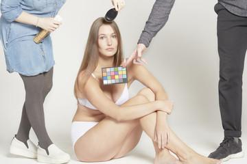 Sitting model has hair brushed.
