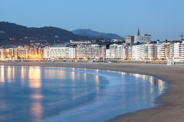 Fototapete - San Sebastian illuminated at night, Spain