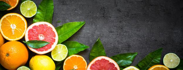 Fresh citrus fruit assortment on black. Long banner  format. Fototapete