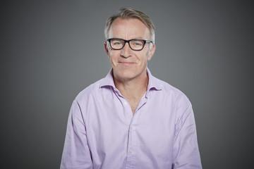 Portrait of mature man wearing glasses.