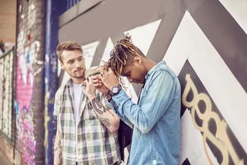 Teenage boys leaning on wall