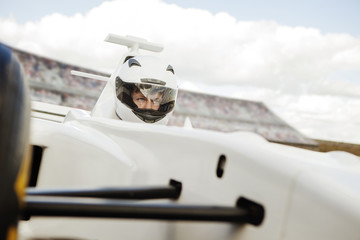 Auto racing driver in his car
