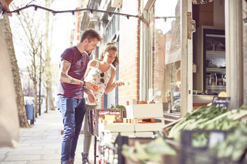 Teenage couple shopping for fruit