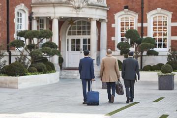 Businessmen walking together