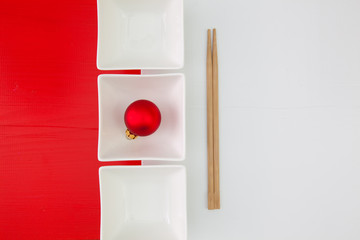 Ceramic bowls and bamboo chopsticks for sushi food
