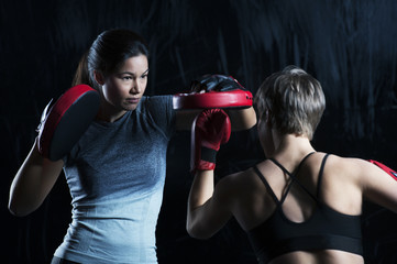 Women boxing together
