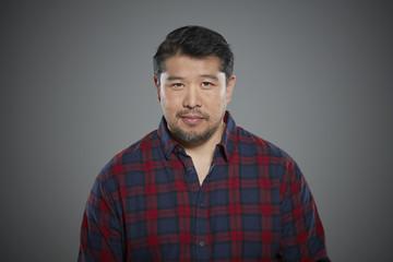 Portrait of man wearing flannel shirt.