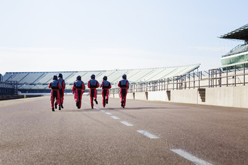Pit crew running to car