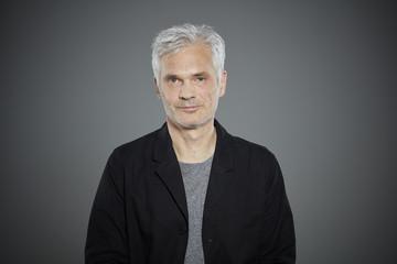 Portrait of mature man wearing black jacket.