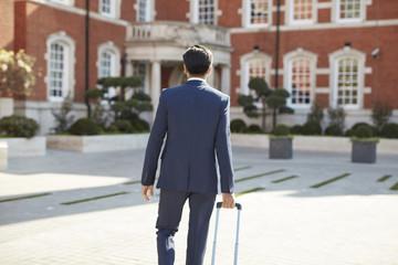 Rear view of businessman walking
