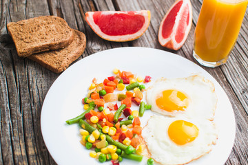 Breakfast on the wooden background from chicken breast