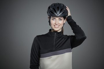 Portrait of young woman wearing bicycle helmet.