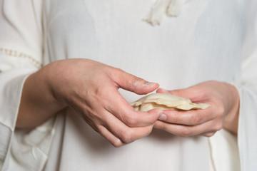 Female Hands preparing a Dim Sum