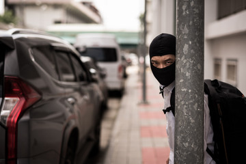 robber in black mask ,robbery concept.