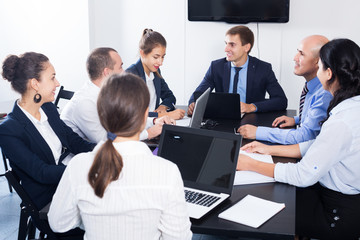 Coworkers meeting at conference room