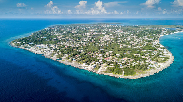 Aerial view of Grand Cayman and its surrounding coral reef