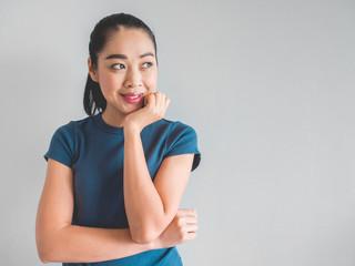 Joyful and satisfied Asian woman.