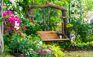 Wood chair in cozy flower garden./ Wood chair in cozy flower garden on summer.