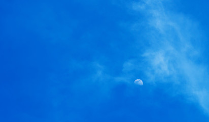 Beautiful blue sky with clouds and moon
