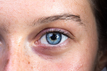 Intense blu eye of young woman looking at the camera