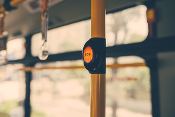 SOS button on yellow holder in modern bus