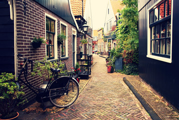 Netherlands. Volendam. The old bicycle stands on an ancient picturesque street in an ancient fishing village.