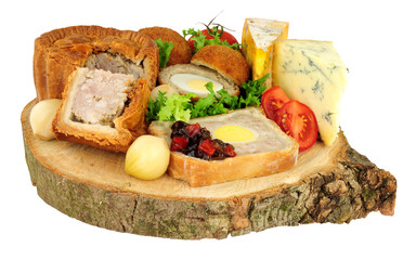 Traditional ploughman's buffet lunch ingredients isolated on a white background