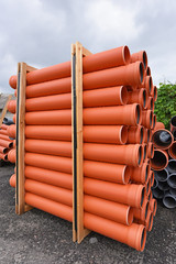 Packing of orange plastic pipes for the sewage system