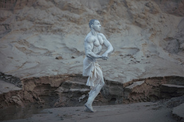 Male athlete is like a statue made of granite.